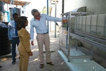 gI_122411_Aquiva Foundation CEO Florian Bollen Explains the Desalination Plant System to Health Minister Dr Sh