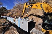 Constructing A Winding Box Culvert Channel In A Steep, Rocky Canyon