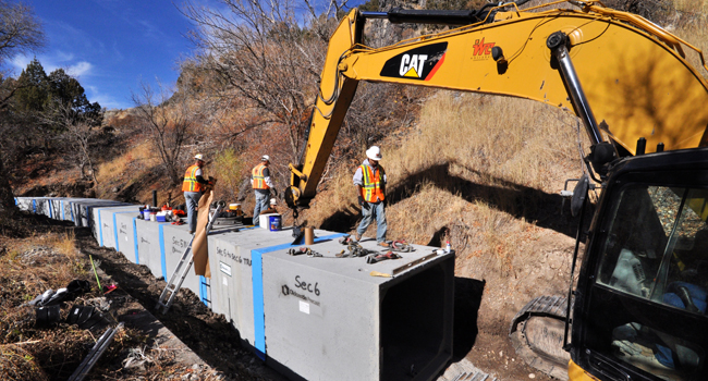 Constructing A Winding Box Culvert Channel In A Steep Rocky Canyon