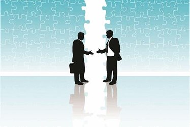 merger aquisition business men hand shake 450x300