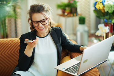 Women Talking On Phone Working From Home