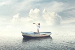 Guy On Boat In Water Looking