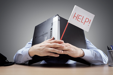 Help-Laptop-Over-Head-Frustrated-iStock-658516626
