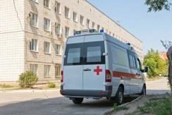 White Ambulance By Hospital