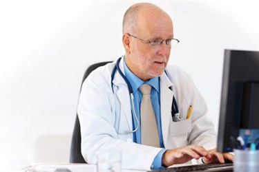 HTO Doctor At Computer