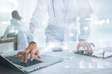 Clinical data laptop iStock-859500980