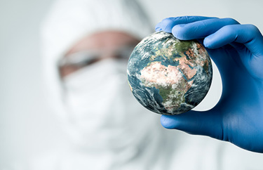 Medical professional with globe