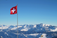 Switzerland-Swiss-Flag-Alps-iStock-1073386184