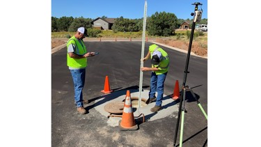 Field crew collecting location of assets using a high accuracy GNSS receiver.
