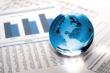 globe on data charts graphs