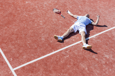Man Lying On Tennis Court