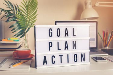 Goal,plan,action text on light box on desk table