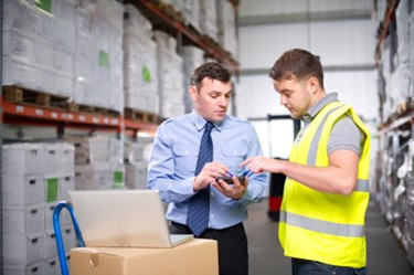 Worker in Warehouse with Mobile Device.jpg