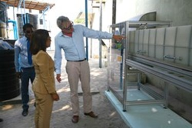 gI_122411_Aquiva Foundation CEO Florian Bollen Explains the Desalination Plant System to Health Minister Dr Sh