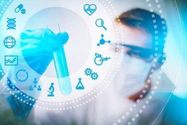 Biotech scientist looking at test tube