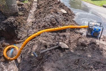 broken-water-line-portable-pump-earthwork_iStock-1128459486_450_300