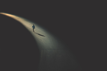 Man Walking IN Shadow