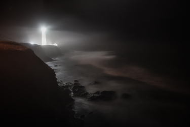 Lighthouse-Harbor-Night-Fog-iStock-1077845204